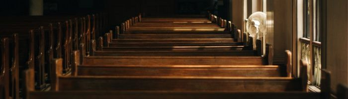 A photo of pews in a church.