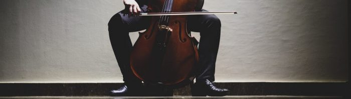 A photo of a person playing the cello.
